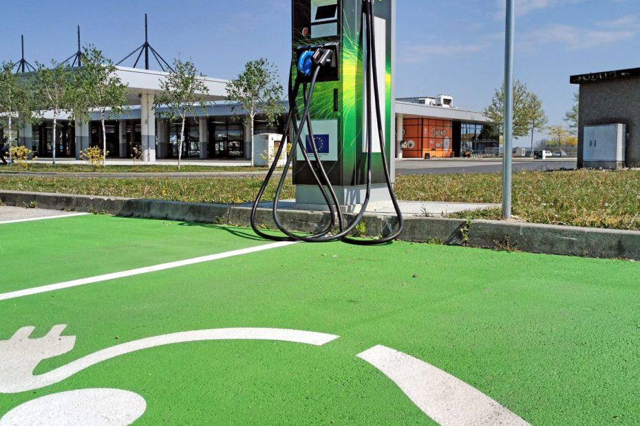 EV charging station on parking lot. Green parking spot for electric vehicles.